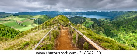 Walking path leading to a view on the lakes of Sete Cidades and Santiago in Sao Miguel, Azores - stock photo