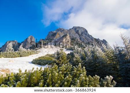 Walking path on top of mountain, in winter season - stock photo