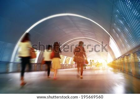 Walking pedestrian tunnel crowd  - stock photo