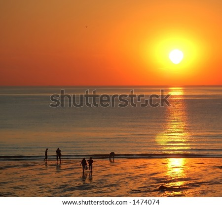 Walking people in the sunset 2 - stock photo