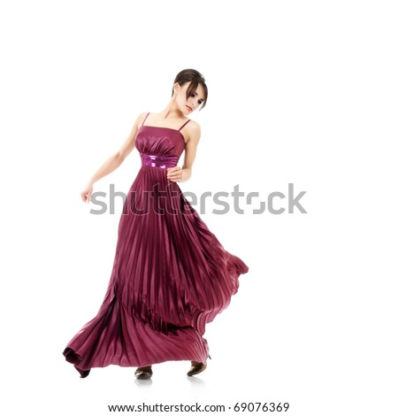 Walking sexy woman with flying dress isolated over white background - stock photo
