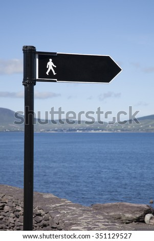 Walking Sign against Sea Background