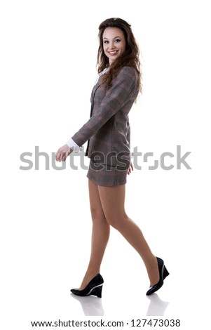 Walking smiling businesswoman isolated on white studio shot