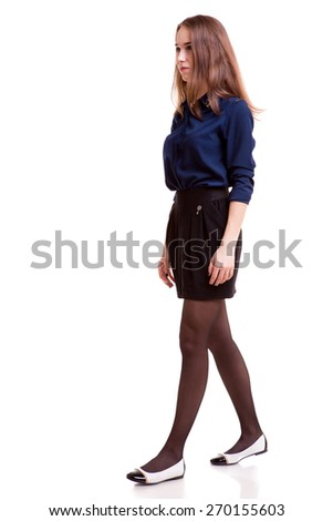 Walking student full body over white background. Studio shooting. Young and successful. Young and rich