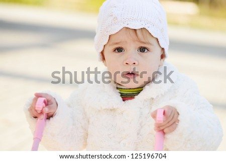 walking surprised baby with stroller - stock photo
