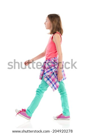 Walking teen girl, side view. Full length studio shot isolated on white. - stock photo