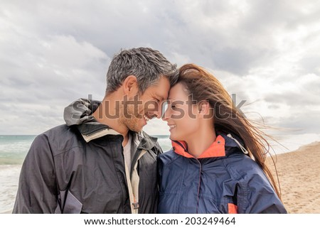 walking the coast in colder season autumn fall - stock photo