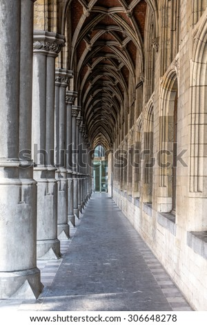 Walking through an archway in Mechelen Belgium - stock photo