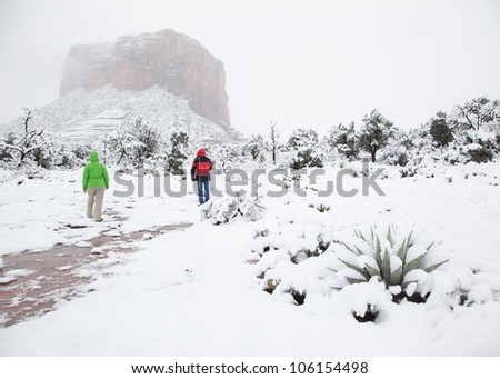Walking Through Freshly Fallen Snow in the Desert (Sedona, Arizona) - stock photo