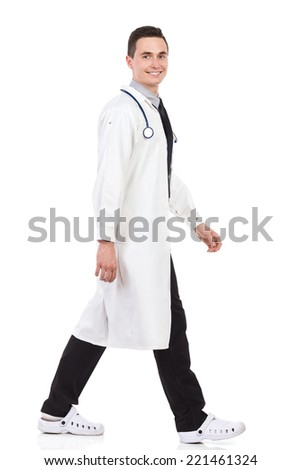 Walking young male doctor. Full length studio shot isolated on white. - stock photo