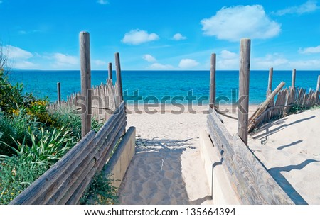walkpath to the beach made with wood and reeds - stock photo