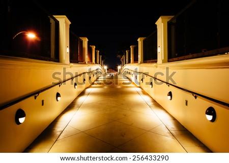 Walkway at night, in Huntington Beach, California. - stock photo