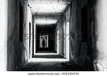 walkway in Abandoned building with scary woman inside, darkness horror and halloween background concept - stock photo