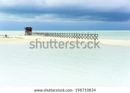 walkway jetty with dramatic cloud background - stock photo