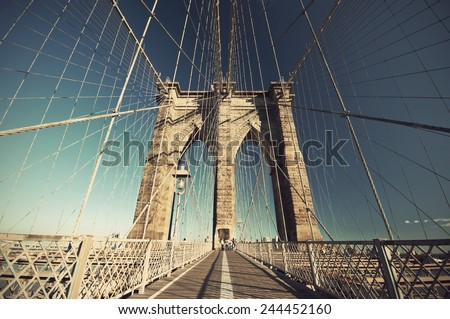 Walkway on the Brooklyn Bridge with blue sky, New York City, USA,  vintage style - stock photo