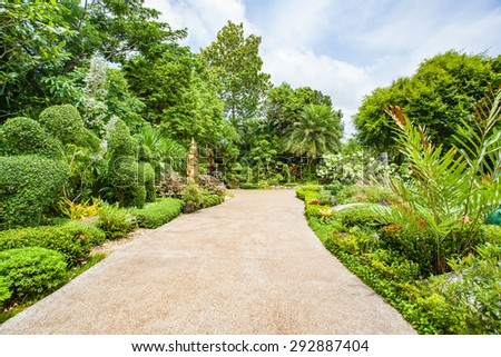 Amazing Walkway Path With Green Trees And Bushes In Garden. Beautiful In Park