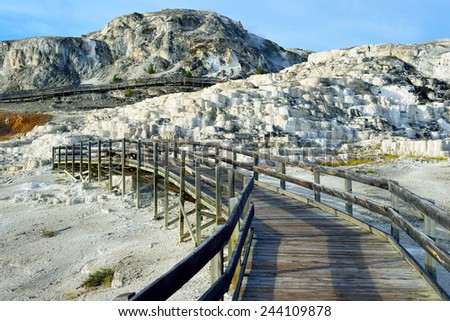walkway through Minerva Terrace in Mammoth Hot Springs area of Yellowstone National Park, Wyoming - stock photo