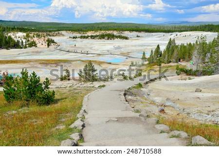 walkway through the Norris Geyser Basin in Yellowstone National Park, Wyoming - stock photo