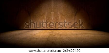 Wall and floor background illuminated by spotlight - stock photo