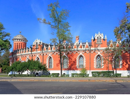 Wall and towers of the seventeenth century palace built in gothic style - stock photo