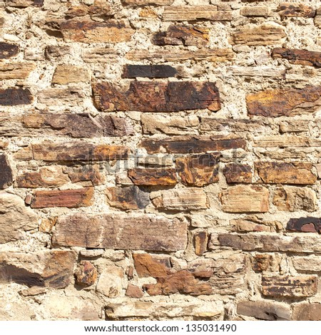wall at an old church - natural stones - use as background or texture