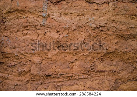 Wall background made clay mold clay into a residential home. - stock photo