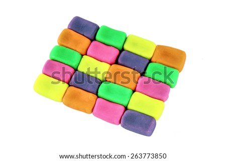 Wall background made of colorful child's play clay bricks - stock photo