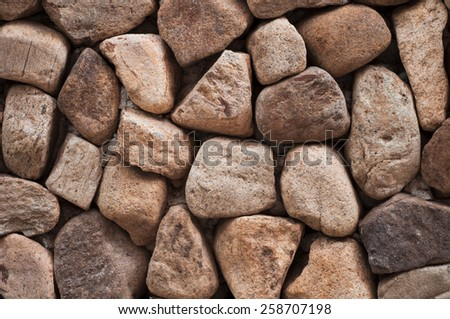 Wall building from sea stones. - stock photo
