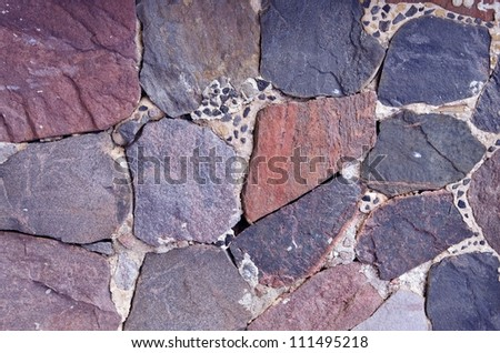 Wall built of large stone pieces. Architectural stone wall background. - stock photo