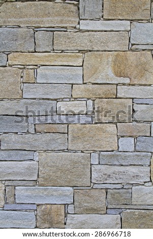 Wall built of natural stone - background - stock photo