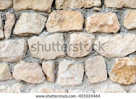 wall built of rough stone - stock photo