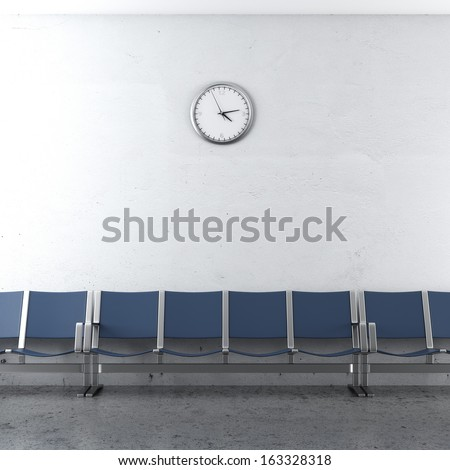 wall clock and blue seats - stock photo