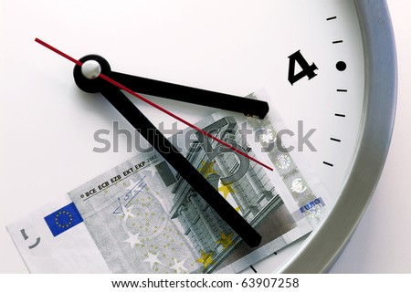 wall clock at 5 o'clock show at 5 euros - stock photo