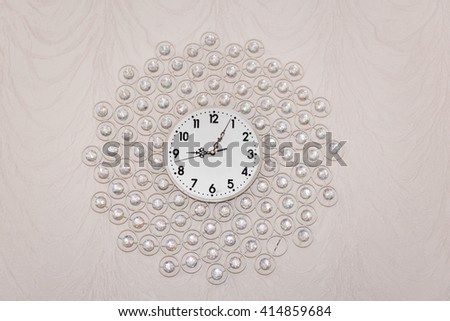 Wall clock decorated with crystals, time flow - stock photo
