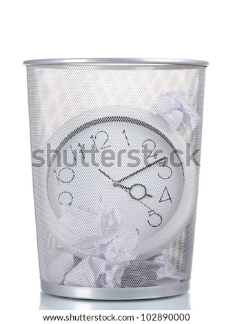 Wall Clock in metal trash bin and paper isolated on white - stock photo