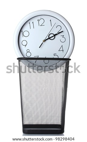 Wall Clock in metal trash bin  isolated on white - stock photo