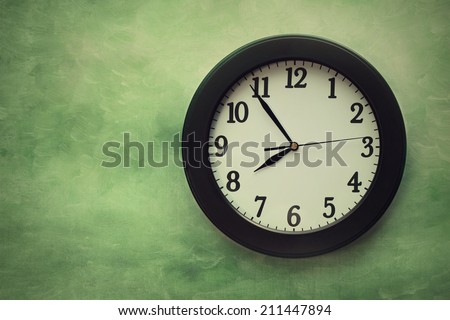 Wall clock on surreal looking background - stock photo