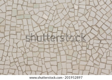 Wall Covered with Irregular Mosaics of White, Very Light Green and Very Light Yellow Color