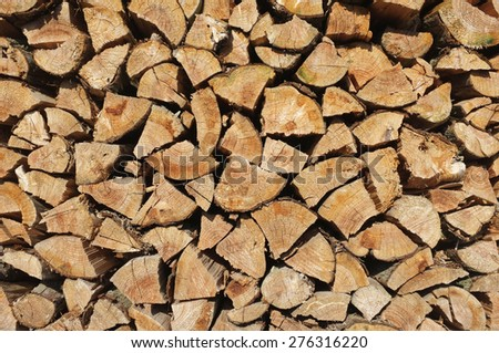 wall firewood at Jeju island , Background of dry chopped firewood logs in a pile - stock photo