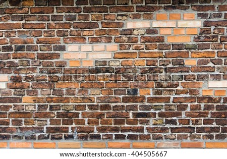 Wall from the combined old and new bricks. Good as background, concept of connection, old and new.