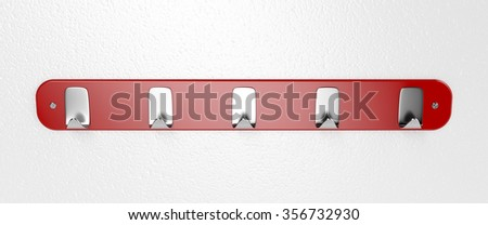 Wall hanger on grey wall - stock photo
