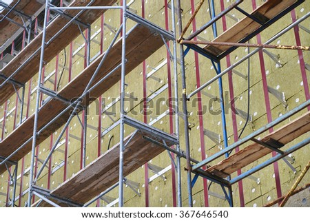 Wall insulation, resource conservation, scaffolding, carrying out aerial work, insulation of facades, - stock photo