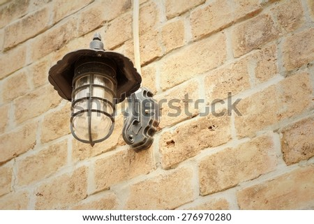 Wall lamp on a rocks background at the park - stock photo