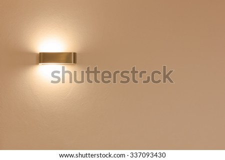 wall lamp shinning in a room - stock photo