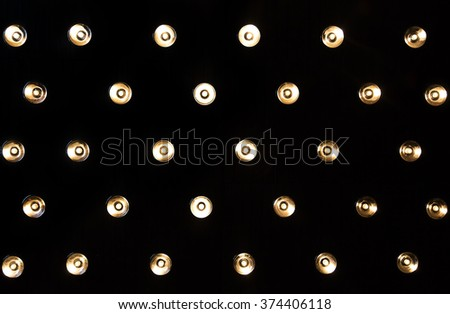 Wall lamps in studios dark background - stock photo