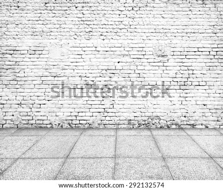 Wall made of bricks and floor from stone - stock photo