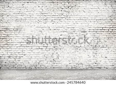 Wall made of bricks and floor from stone.  Place for text  - stock photo