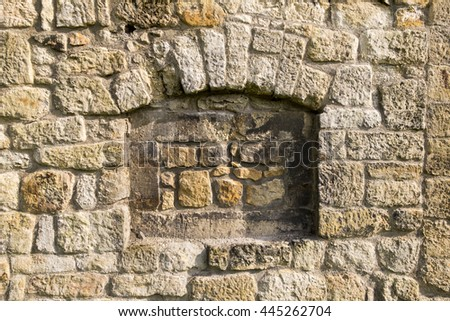 Wall made of natural sandstone rough fractured surfaces, laid as a brick. Stone wall background texture. Taupe cut block sandstone old wall. - stock photo