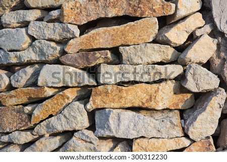 Wall made of natural stone - stock photo