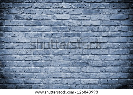 Wall made �¢??�¢??of old bricks in the color cyan